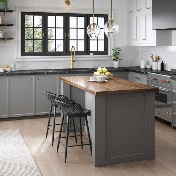 A mixture of counter surfaces in a gray kitchen