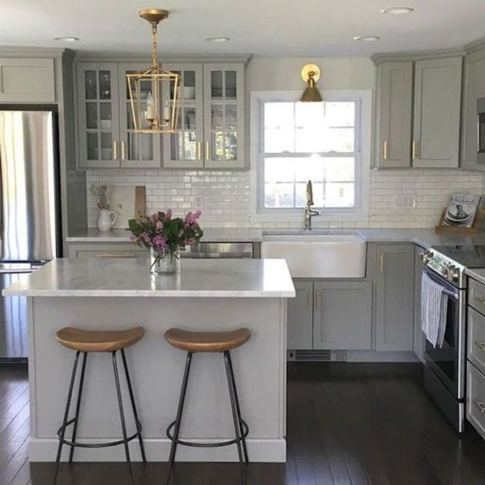 Country Style Grey Cabinets With A White Farmhouse Sink