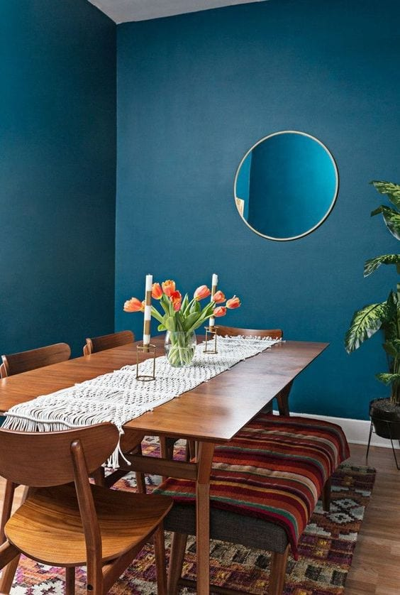 Mid century dining room with blue walls